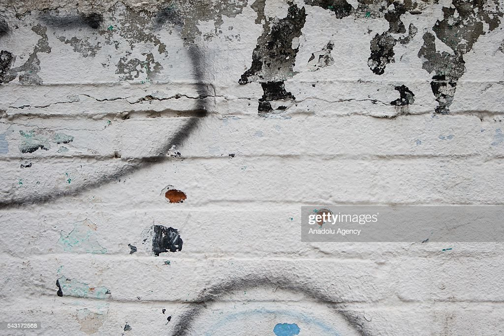 Alleged bullet holes are seen in the wall of the municipal cemetery after the demonstrations, protesting the Educative Reform and the jailing of their leaders in Oaxaca, Mexico on June 26, 2016. At least 11 people killed and more of 100 people injured in Nochixtlan, Mexico.