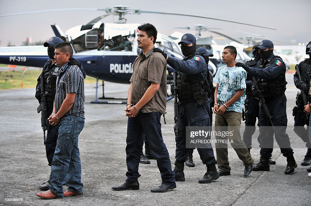 Alleged members of the drug trafficking gang 'Cartel del Pacifico' are escorted to a press conference at the Mexican Federal Police Headquarters in Mexico City on August 10, 2009. Mexican President Felipe Calderon joins leaders of the US and Canada Monday to plot vicious drugs cartels, counter-attacks against swine flu and economic blight at a North American summit. Security forces swamped the western Mexican city of Guadalajara for the swift summit, where tactical adjustments rather than breakthroughs are expected against building threats to a diverse region of nearly 450 million people. AFP PHOTO/Alfredo ESTRELLA