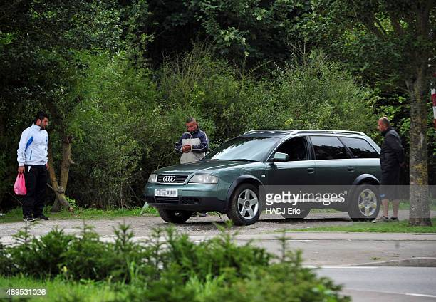 Alleged migrant smugglers and human traffickers near the imigrants camp of GrandeSynthe in the north of France a car registered in Great Britain is...