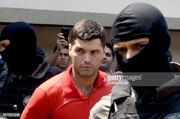 Alleged serial killer Tiago Gomes da Rocha suspected of killing 39 people is escorted by police officers at the Department of Security a day after...