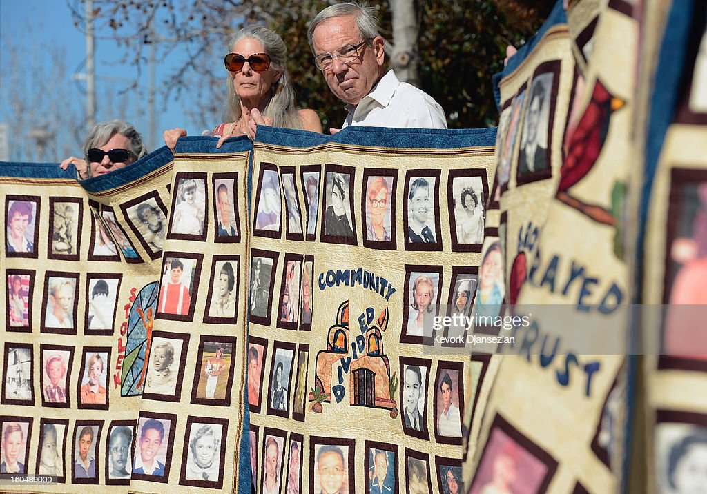Alleged sexual abuse victim Mary Ferrell (C) holds up quilt with pictures of other alleged victims of sexual abuse by priests in the Catholic Archdiocese of Los Angeles during a news conference urging victims to come forward on February 1, 2013 at Cathedral of Our Lady of the Angels in Los Angeles, California. Retired Cardinal Roger Mahony of Catholic Archdiocese of Los Angeles, who avoided criminal charges over the way he handled pedophile priests during his career, was reportedly stripped of his archdiocese duties February 1, by his successor Archbishop Jose Gomez.
