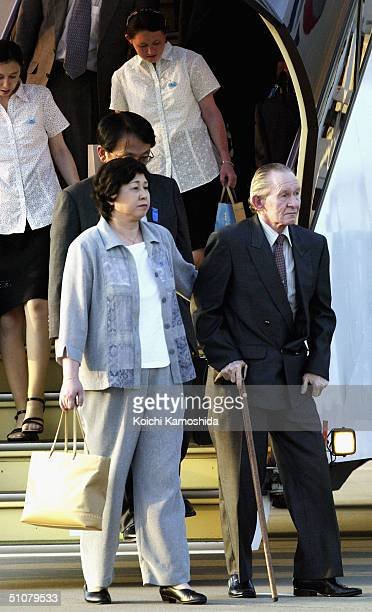 Alleged US Army deserter Charles Jenkins and his wife Hitomi Soga arrive at Haneda International Airport July 18 2004 in Tokyo The US Army has...