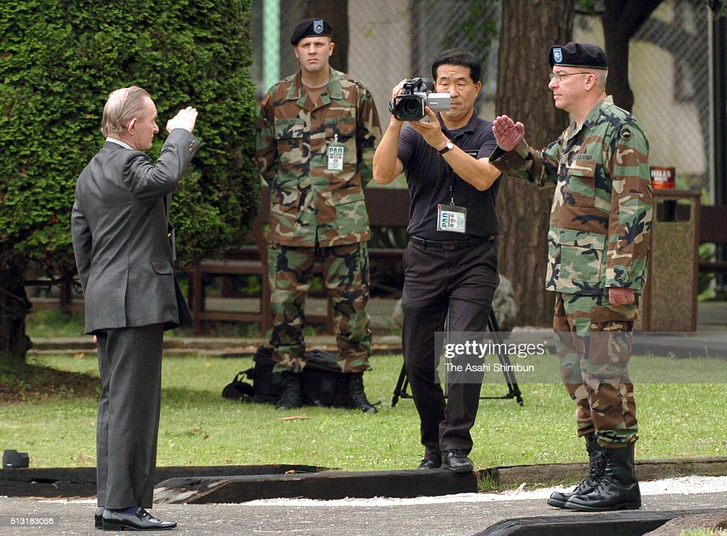 Alleged US Army deserter Charles Jenkins salutes to the chief of provost marshall Lieutenant Colonel Paul Nigara at US Army's Camp Zama on September...