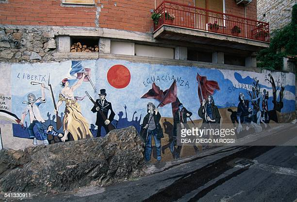 Allegorical procession led by Freedom murals of Orgosolo Sardinia Italy