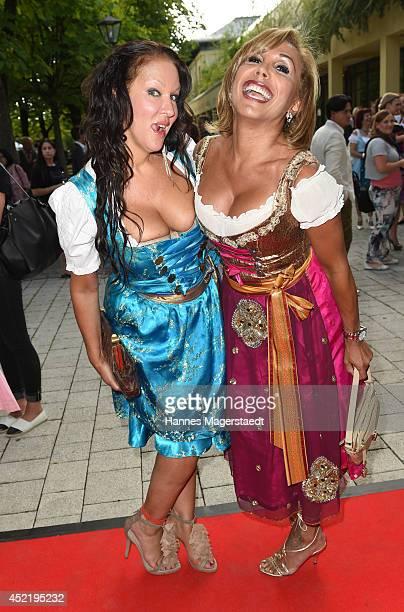 Allegra Camilla Curtis and Julia Prillwitz attends the Sixt ladies dirndl dinner on July 15 2014 in Munich Germany