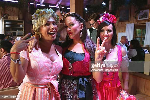 Allegra Curtis attends with Angelika Zwerenz and Jutta Prillwitz the opening day at Fisch Baeder's Wiesenstadl of the 2014 Oktoberfest at...