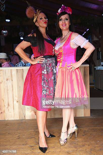 Allegra Curtis attends with Angelika Zwerenz the opening day at Fisch Baeder's Wiesenstadl of the 2014 Oktoberfest at Theresienwiese on September 20...