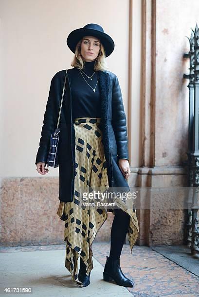 Allegra Marzorati poses wearing a Calvin Klein coat Westwood Red Label skirt and Vivienne Westwood bag during day 2 of Milan Menswear Fashion Week...