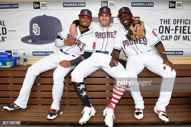 Allen Cordoba Chase d'Arnaud and Jose Pirela of the San Diego Padres pose for a photo in the dugout prior to the game against the Los Angeles Dodgers...