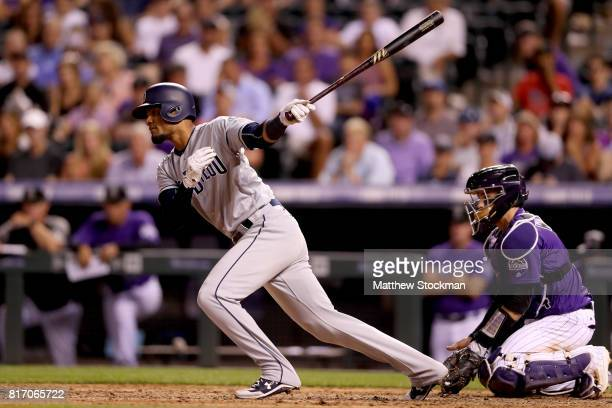 Allen Cordoba hits a RBI single in the eighth inning against the San Diego Padres at Coors Field on July 17 2017 in Denver Colorado