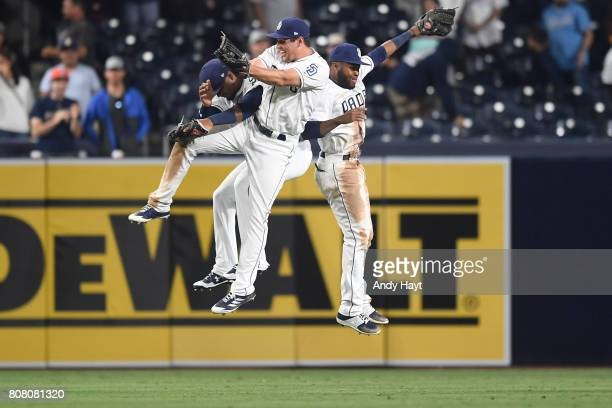 Allen Cordoba Hunter Renfroe and Manuel Margo of the San Diego Padres celebrate after the final out during the game against the Atlanta Braves at...