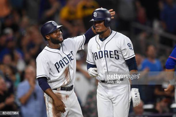 Allen Cordoba is congratulated by Manuel Margot of the San Diego Padres after hitting a home run during the game against the New York Mets at PETCO...