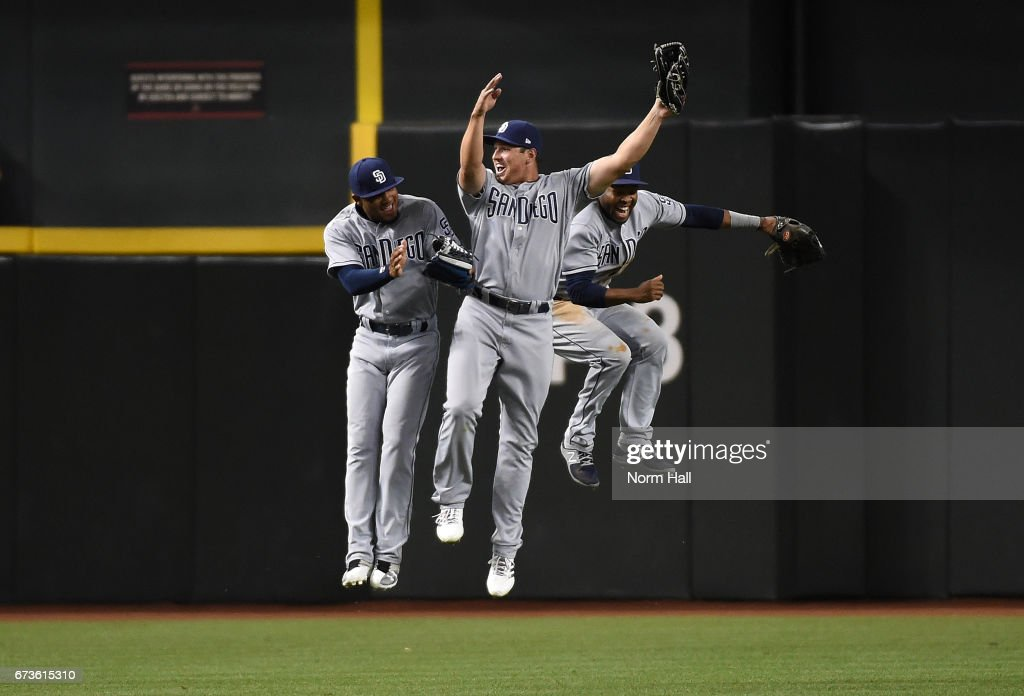 Allen Cordoba #17, Manuel Margot #7 and Hunter Renfroe #10 of the San Diego Padres celebrate an 8-5 win against the Arizona Diamondbacks at Chase Field on April 26, 2017 in Phoenix, Arizona.