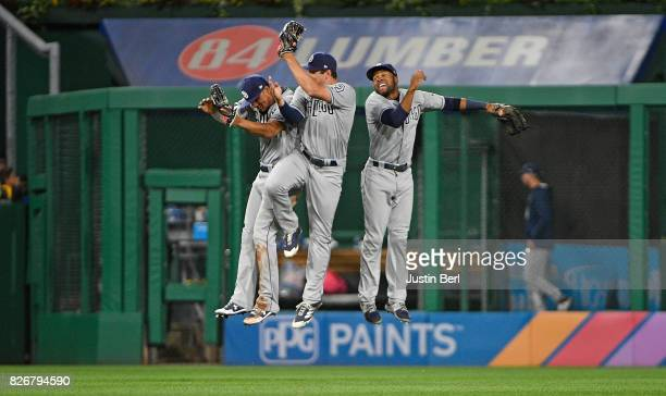 Allen Cordoba of the San Diego Padres celebrates with Manuel Margot and Hunter Renfroe after the final out in the San Diego Padres 52 win over the...