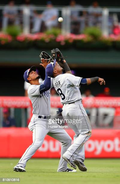 Allen Cordoba of the San Diego Padres collides with Erick Aybar as he catches a fly ball in the eighth inning during a game against the Philadelphia...