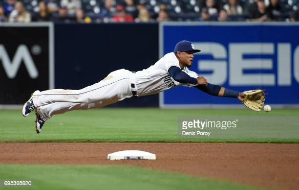 Allen Cordoba of the San Diego Padres dives but can't make the catch on a single hit by Scott Schebler of the Cincinnati Reds during the seventh...