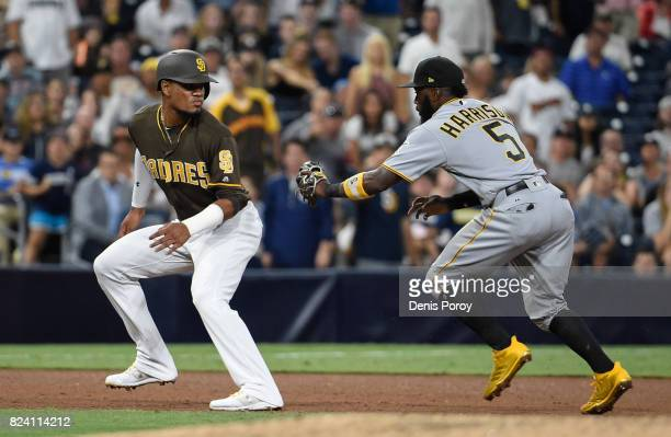 Allen Cordoba of the San Diego Padres is tagged out in a run down by Josh Harrison of the Pittsburgh Pirates during the fourth inning of a baseball...