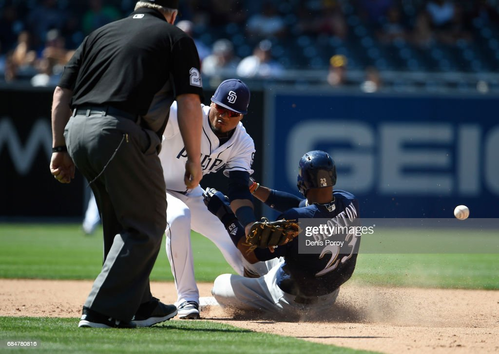Allen Cordoba #17 of the San Diego Padres loses the ball as Keon Broxton #23 of the Milwaukee Brewers steals second base during the ninth inning of a baseball game at PETCO Park on May 18, 2017 in San Diego, California.