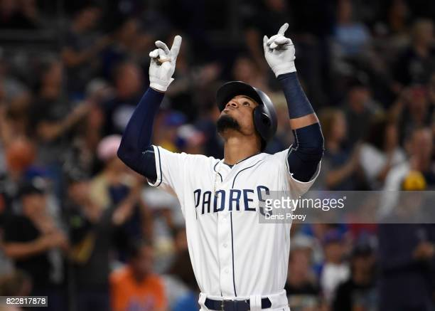 Allen Cordoba of the San Diego Padres points skyward after hitting a tworun home run during the second inning of a baseball game against the New York...
