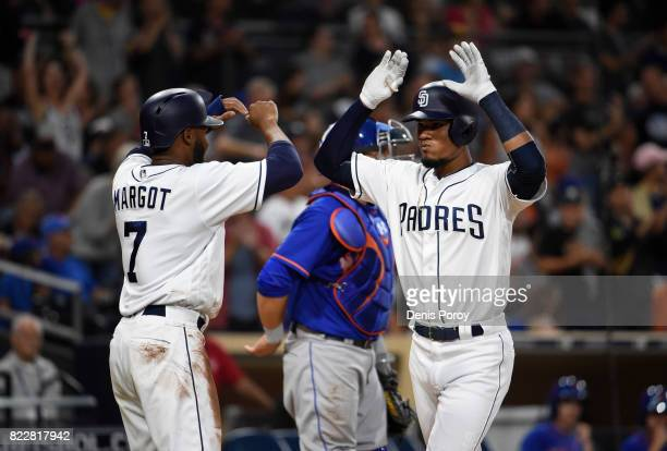 Allen Cordoba of the San Diego Padres right is congratulated by Manuel Margot after hitting a tworun home run during the second inning of a baseball...