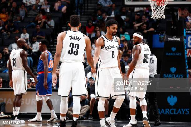 Allen Crabbe and Spencer Dinwiddie of the Brooklyn Nets high five during a preseason game against the New York Knicks on October 8 2017 at Barclays...