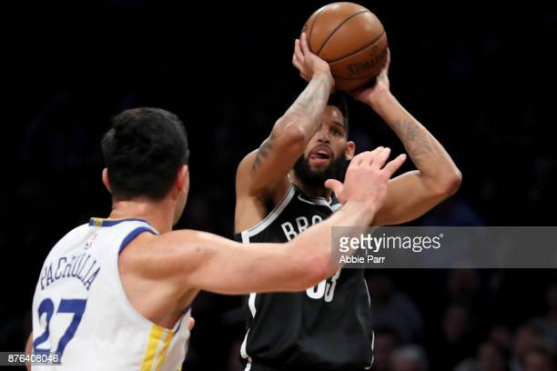 Allen Crabbe of the Brooklyn Nets takes a shot against Zaza Pachulia of the Golden State Warriors in the first quarter during their game at Barclays...