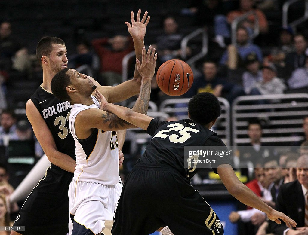 Allen Crabbe #23 of the California Golden Bears looses the ball between Austin Dufault #33 and Spencer Dinwiddie #25 of the Colorado Buffaloes in the second half in the semifinals of the 2012 Pacific Life Pac-12 men's basketball tournament at Staples Center on March 9, 2012 in Los Angeles, California.