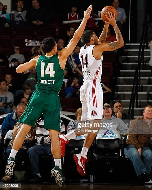 Allen Crabbe of the Idaho Stampede shoots past Trent Lockett of the Reno Bighorns during an NBA DLeague game on March 15 2014 at CenturyLink Arena in...