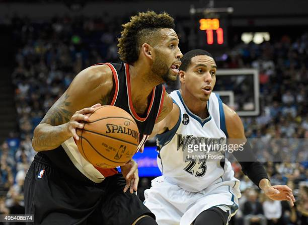 Allen Crabbe of the Portland Trail Blazers drives to the basket against Kevin Martin of the Minnesota Timberwolves during the first quarter of the...