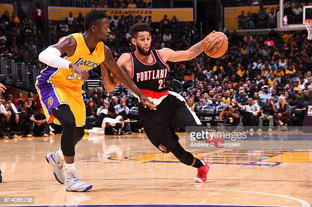Allen Crabbe of the Portland Trail Blazers drives to the basket against Julius Randle of the Los Angeles Lakers during a preseason game on October 11...