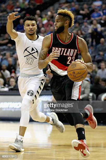 Allen Crabbe of the Portland Trail Blazers drives to the basket against Jamal Murray of the Denver Nuggets at the Pepsi Center on December 15 2016 in...