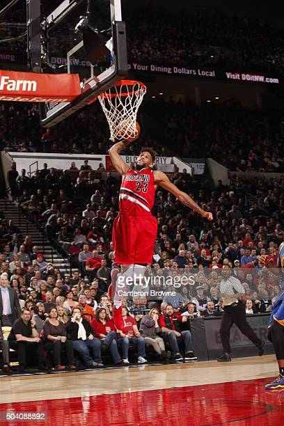 Allen Crabbe of the Portland Trail Blazers goes to the basket against the Golden State Warriors on January 8 2016 at the Moda Center in Portland...