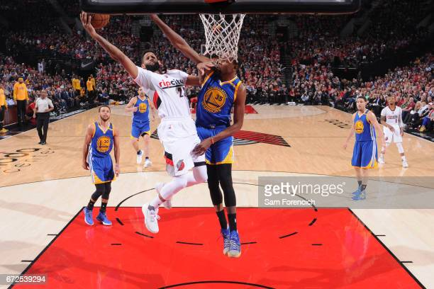 Allen Crabbe of the Portland Trail Blazers goes to the basket against the Golden State Warriors during Game Four of the Western Conference...
