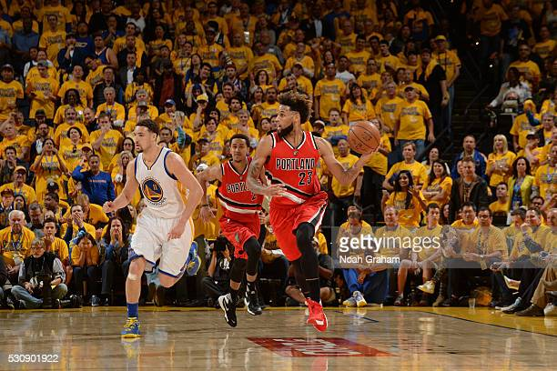 Allen Crabbe of the Portland Trail Blazers handles the ball against the Golden State Warriors in Game Five of the Western Conference Semifinals of...