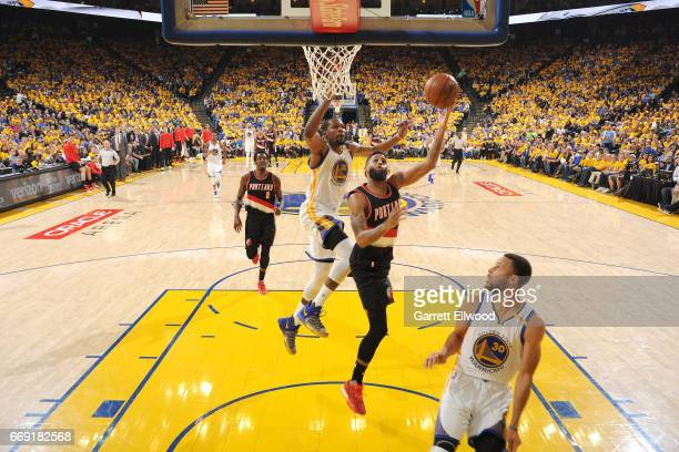 Allen Crabbe of the Portland Trail Blazers shoots a lay up and gets blocked by Kevin Durant of the Golden State Warriors during the game during the...