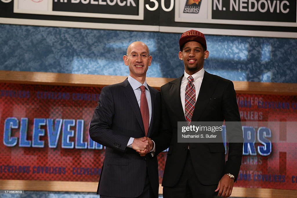 Allen Crabbe shakes hands with NBA Deputy Commissioner, Adam Silver after being selected number thirty first overall by the Cleveland Cavaliers during the 2013 NBA Draft on June 27, 2013 at Barclays Center in Brooklyn, New York.