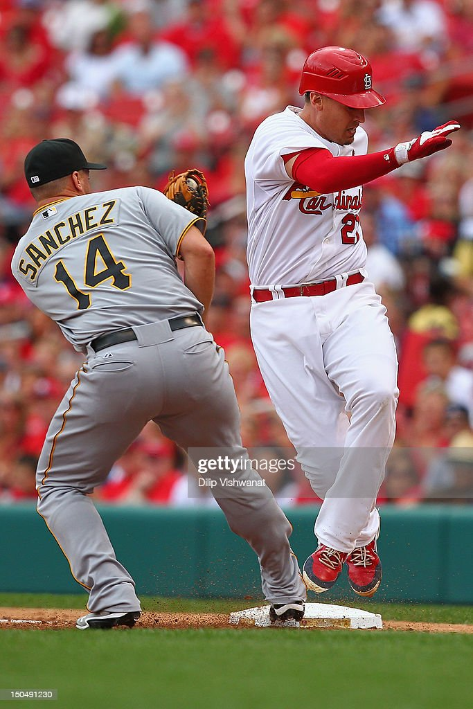 <a gi-track='captionPersonalityLinkClicked' href=/galleries/search?phrase=Allen+Craig&family=editorial&specificpeople=4405049 ng-click='$event.stopPropagation()'>Allen Craig</a> #21 of the St. Louis Cardinals avoids being tagged out at first base by <a gi-track='captionPersonalityLinkClicked' href=/galleries/search?phrase=Gaby+Sanchez&family=editorial&specificpeople=4945789 ng-click='$event.stopPropagation()'>Gaby Sanchez</a> #14 of the Pittsburgh Pirates at Busch Stadium on August 19, 2012 in St. Louis, Missouri.