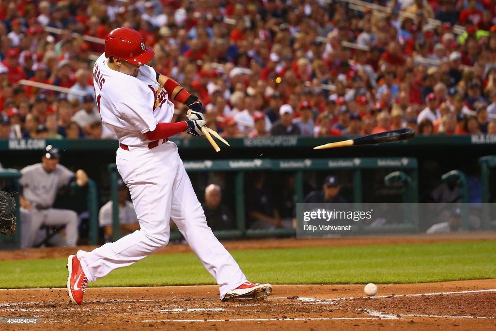 Allen Craig #21 of the St. Louis Cardinals breaks his bat after making contact against the New York Yankees in the third inning at Busch Stadium on May 27, 2014 in St. Louis, Missouri. A fielding error allowed a run to score on the play.