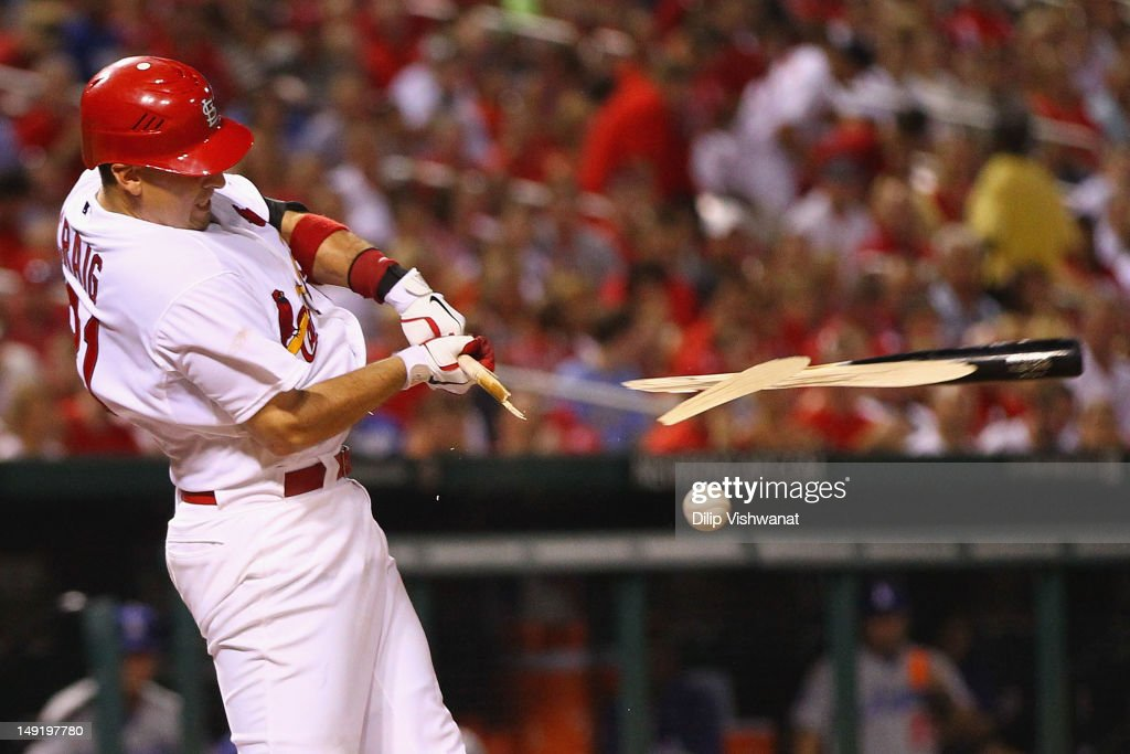 <a gi-track='captionPersonalityLinkClicked' href=/galleries/search?phrase=Allen+Craig&family=editorial&specificpeople=4405049 ng-click='$event.stopPropagation()'>Allen Craig</a> #21 of the St. Louis Cardinals breaks his bat during an at-bat against the Los Angeles Dodgers at Busch Stadium on July 24, 2012 in St. Louis, Missouri.