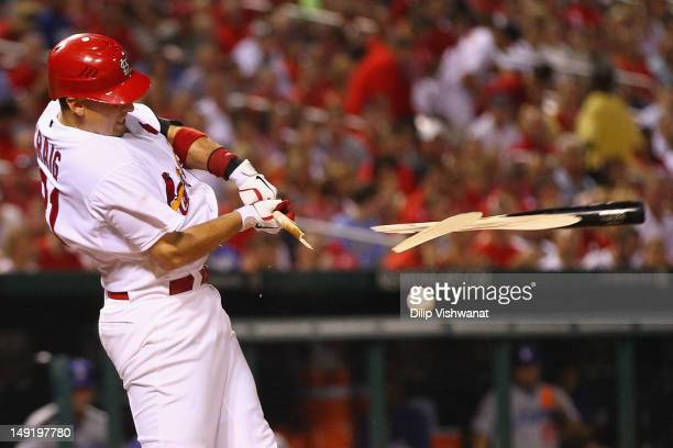 Allen Craig of the St Louis Cardinals breaks his bat during an atbat against the Los Angeles Dodgers at Busch Stadium on July 24 2012 in St Louis...