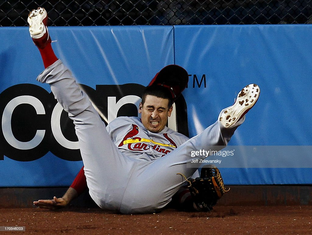 <a gi-track='captionPersonalityLinkClicked' href=/galleries/search?phrase=Allen+Craig&family=editorial&specificpeople=4405049 ng-click='$event.stopPropagation()'>Allen Craig</a> #21 of the St. Louis Cardinals catches a long fly ball off the bat of Marlon Byrd #6 of the New York Mets at Citi Field on June 11, 2013 in the Flushing neighborhood of the Queens borough of New York City.