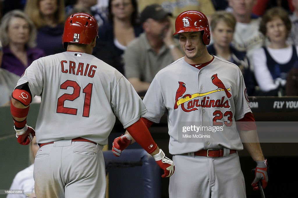 Allen Craig #21 of the St. Louis Cardinals celebrates with David Freese #23 after hitting a solo home run in the top of the sixth inning against the Milwaukee Brewers at Miller Park on May 04, 2013 in Milwaukee, Wisconsin.