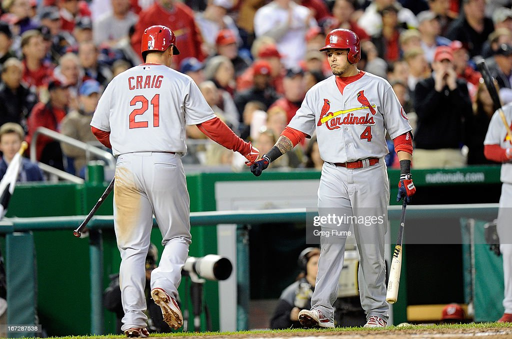 <a gi-track='captionPersonalityLinkClicked' href=/galleries/search?phrase=Allen+Craig&family=editorial&specificpeople=4405049 ng-click='$event.stopPropagation()'>Allen Craig</a> #21 of the St. Louis Cardinals celebrates with <a gi-track='captionPersonalityLinkClicked' href=/galleries/search?phrase=Yadier+Molina&family=editorial&specificpeople=172002 ng-click='$event.stopPropagation()'>Yadier Molina</a> #4 after scoring in the fourth inning against the Washington Nationals at Nationals Park on April 23, 2013 in Washington, DC.