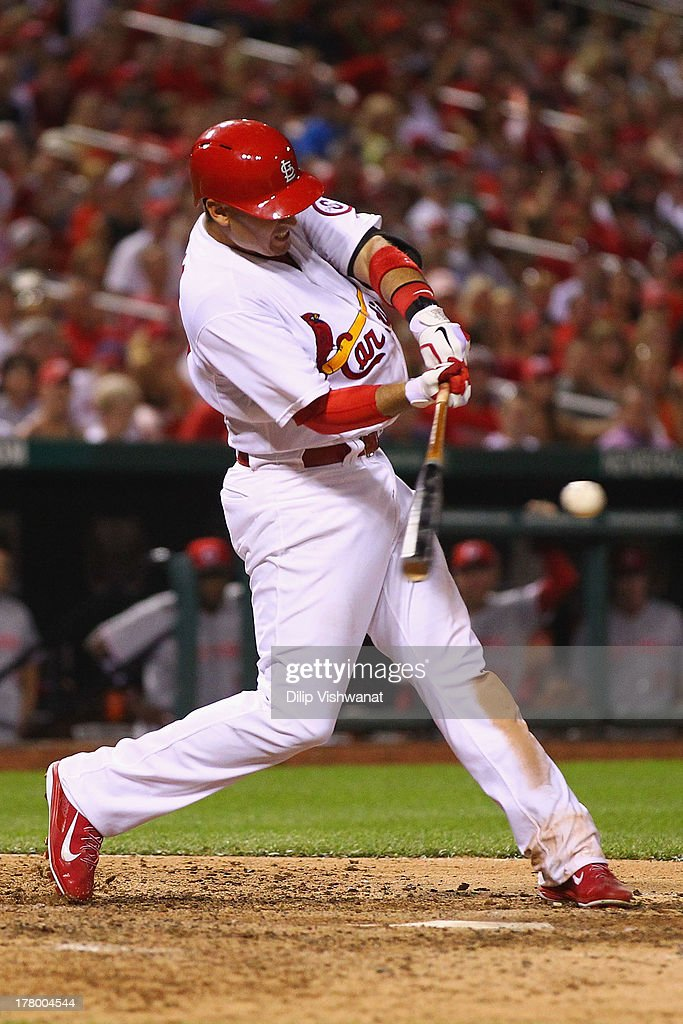 <a gi-track='captionPersonalityLinkClicked' href=/galleries/search?phrase=Allen+Craig&family=editorial&specificpeople=4405049 ng-click='$event.stopPropagation()'>Allen Craig</a> #21 of the St. Louis Cardinals hits a grand slam against reliever J.J. Hoover #60 of the Cincinnati Reds in the seventh inning at Busch Stadium on August 26, 2013 in St. Louis, Missouri.