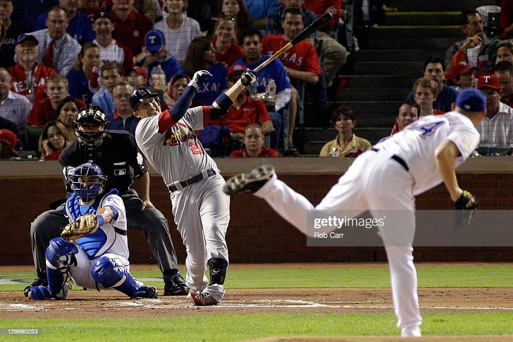 Allen Craig #21 of the St. Louis Cardinals hits a homerun in the first inning off of Matt Harrison #54 of the Texas Rangers during Game Three of the MLB World Series at Rangers Ballpark in Arlington on October 22, 2011 in Arlington, Texas.