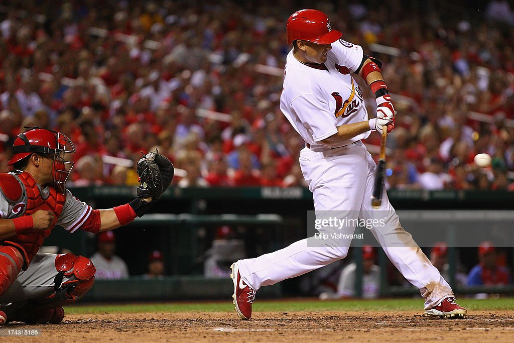 <a gi-track='captionPersonalityLinkClicked' href=/galleries/search?phrase=Allen+Craig&family=editorial&specificpeople=4405049 ng-click='$event.stopPropagation()'>Allen Craig</a> #21 of the St. Louis Cardinals hits an RBI single against the Philadelphia Phillies in the seventh inning at Busch Stadium on July 23, 2013 in St. Louis, Missouri. The Cardinals beat the Phillies 4-1.
