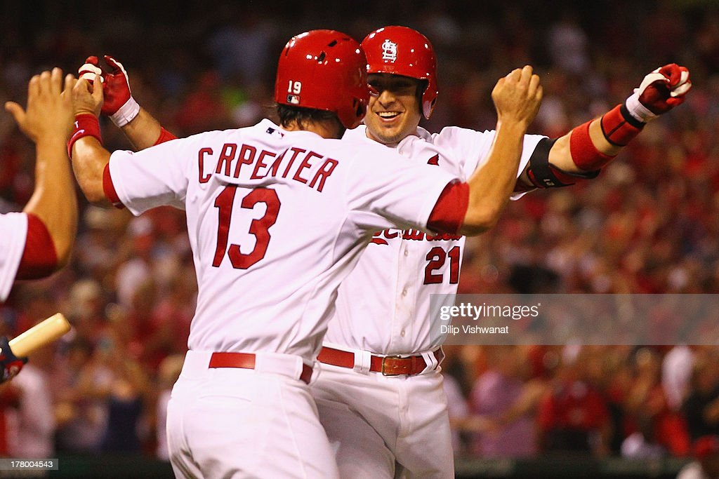 <a gi-track='captionPersonalityLinkClicked' href=/galleries/search?phrase=Allen+Craig&family=editorial&specificpeople=4405049 ng-click='$event.stopPropagation()'>Allen Craig</a> #21 of the St. Louis Cardinals is congratulated by teammates after hitting a grand slam against reliever J.J. Hoover #60 of the Cincinnati Reds in the seventh inning at Busch Stadium on August 26, 2013 in St. Louis, Missouri.