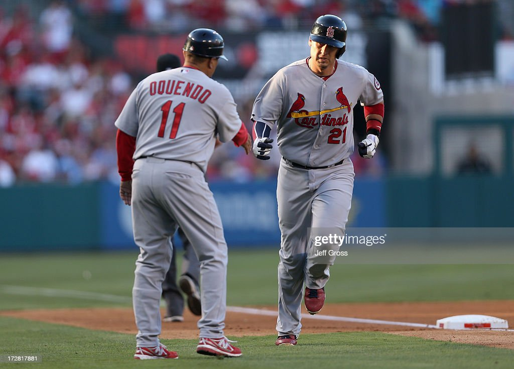 <a gi-track='captionPersonalityLinkClicked' href=/galleries/search?phrase=Allen+Craig&family=editorial&specificpeople=4405049 ng-click='$event.stopPropagation()'>Allen Craig</a> #21 of the St. Louis Cardinals is congratulated by third base coach <a gi-track='captionPersonalityLinkClicked' href=/galleries/search?phrase=Jose+Oquendo&family=editorial&specificpeople=547963 ng-click='$event.stopPropagation()'>Jose Oquendo</a> #11 after hitting a three-run home run against the Los Angeles Angels of Anaheim in the fourth inning at Angel Stadium of Anaheim on July 4, 2013 in Anaheim, California.