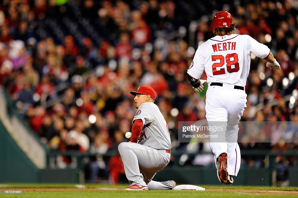 <a gi-track='captionPersonalityLinkClicked' href=/galleries/search?phrase=Allen+Craig&family=editorial&specificpeople=4405049 ng-click='$event.stopPropagation()'>Allen Craig</a> #21 of the St. Louis Cardinals is unable to make a catch from Pete Kozma #38 allowing <a gi-track='captionPersonalityLinkClicked' href=/galleries/search?phrase=Jayson+Werth&family=editorial&specificpeople=206490 ng-click='$event.stopPropagation()'>Jayson Werth</a> #28 of the Washington Nationals to reach first base during the fourth inning of a game at Nationals Park on April 22, 2013 in Washington, DC.