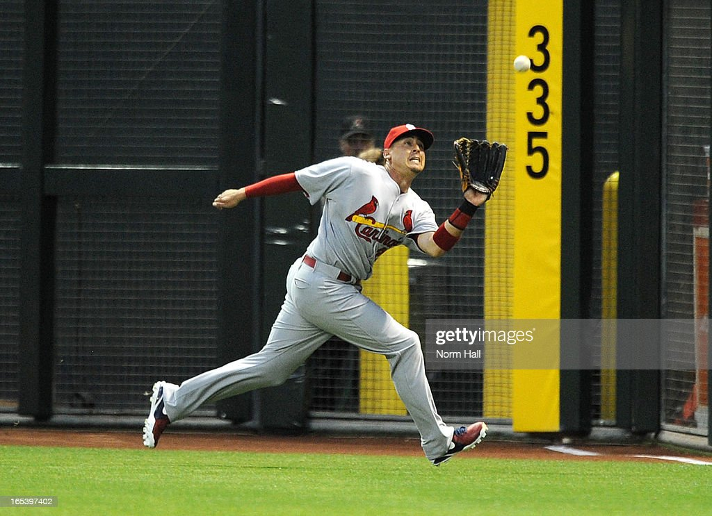<a gi-track='captionPersonalityLinkClicked' href=/galleries/search?phrase=Allen+Craig&family=editorial&specificpeople=4405049 ng-click='$event.stopPropagation()'>Allen Craig</a> #21 of the St Louis Cardinals makes a running catch in the first inning against the Arizona Diamondbacks at Chase Field on April 3, 2013 in Phoenix, Arizona.